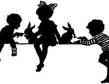 Silhouette of Children Feeding Rabbits