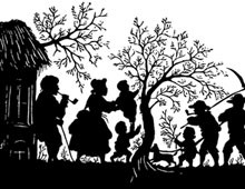 Silhouette of a Family Outside by a Tree