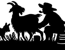 Silhouette of a Man Milking a Goat