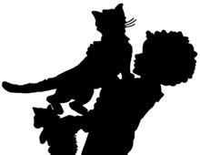 Silhouette of Boy and Cats Playing
