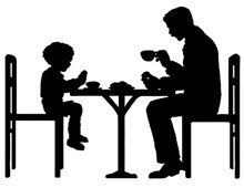 Silhouette of Father and Son Eating Together